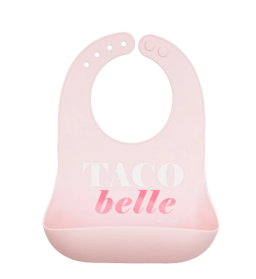 """Pink silicone bib with the words """"Taco Belle"""""""